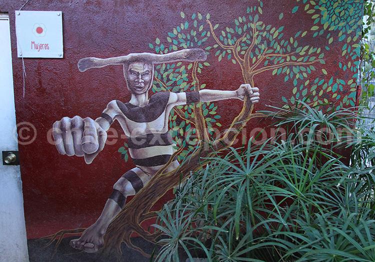 Art de rue représentant un Selknam, Bellavista