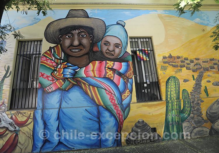 Peinture d'un père andin et son enfant sur les murs de Santiago, Yungay avec l'agence de voyage Chile Excepción