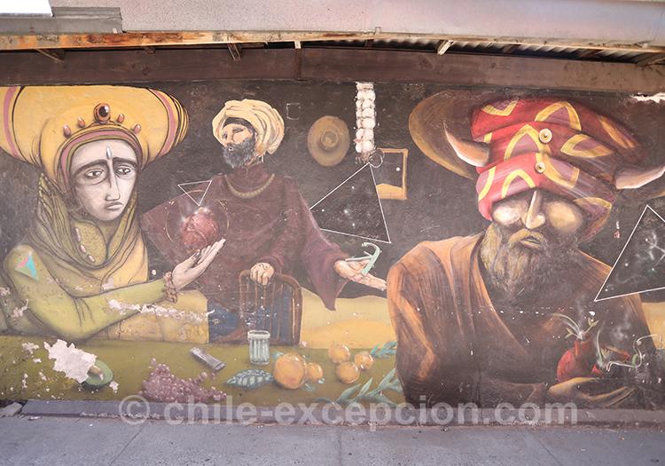 Visages sur un mur à Yungay, Santiago